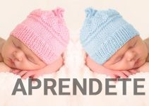 Newborn babies in pink and girl knitted hats.
